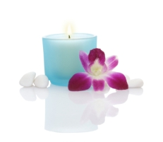 Candles, Orchid and Some White Pebbles on white background